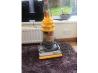 Dyson vacuum cleaner, powerful machine, large head in grey and yellow for sale, new hose required