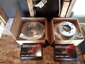 Drilled and slotted rotors with pads for an Eagle Talon