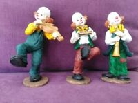 Circus clowns playing instruments.