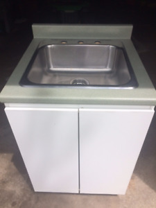 laundry cabinet and stainless steel sink