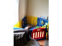 Plastic playpen with mats and toys
