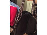 Ladies black chained shoulder handbag with strap