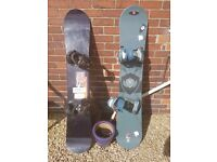 2 snowboards with bindings and bag carrier