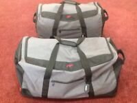 """""""New"""" pair of matching IT ultra lightweight airline luggage holders"""