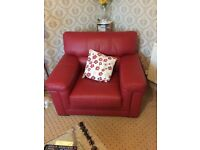 Red leather sofa (196cm x 98cm) and armchair (113cm x 98cm). As good as new, £250
