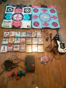 PS2.   21 games, guitar, microphones, dance pads, eyetoy camera