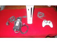 X box 360 60gb version with wired controller.