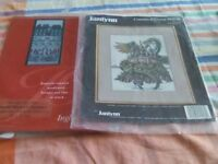 Two counted cross stitch charts.1 is Claude Monets Sampler. 1is a dragon wrapped around a castle.