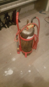 Acetylene b tank, torch and regulator, and carrier