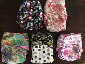 Hybrid fitted cloth diapers