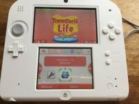 Nintendo 2ds with tomodachi life installed on it.
