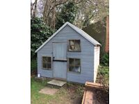 Wooden two-storey children's playhouse