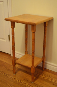 Cute solid wood two-tier table. Would be a great nightstand or a