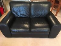 Two seater black leather sofa. Excellent condition.