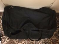 Very big suitcase with handle and 2 wheels in very good Condition