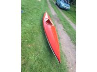 kayak complete with paddle and spray deck