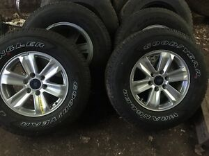 4 Stock F-150 rims and stock Goodyear wranglers, NEVER USED