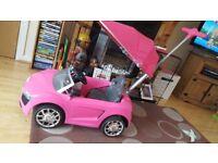 Girls pink Audi ride in car