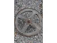 old wooden wheelbarrow wheel
