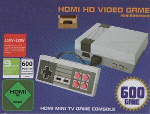 Nintendo mini classic avec 2 mannettes et 600 jeux intégrés HDMI