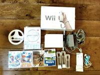 NINTENDO Wii Console Bundle w/ GAMES in excellent, WORKING CONDITION PLUS 5 GAMES!