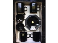Six ultra chic black glass espresso cups and saucers