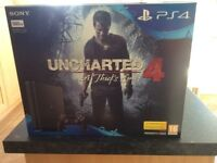 PS4 console, BRAND NEW STILL IN BOX with controller and uncharted 4 game