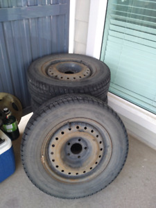 *** MUST GO *** Dunlop Winter Tires on steelies. 215/60/15