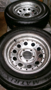 Two trailer wheels. 195/70R14 A set of two wheels and tires in e