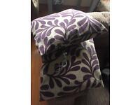 2 large purple cushions