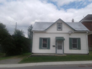 Freshly painted 2 bedroom with up stairs sitting nock -Large Lot
