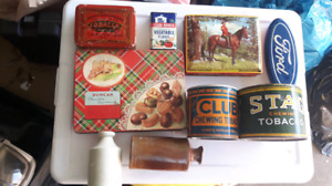 Vintage tins and old clay bottles