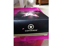 Pink baby converse shoes size 4