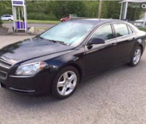 Chevrolet Malibu black colour(low kms) in reduced price.
