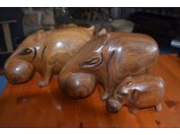 A family of wooden Hippos