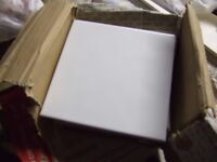 Small batch of white wall tiles