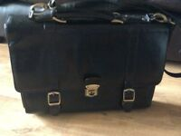 Black leather brief case with shoulder strap