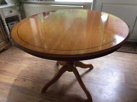 Round extending dining table solid wood