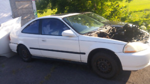 1998 civic body with no engine and a 1999 honda civic engine