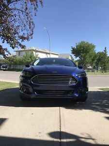 2014 FORD FUSION REDUCED TO SELL LOW KMS