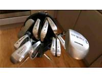 Set of golf clubs with bag, stand, balls and tees