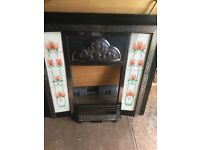 Cast iron and tiled fire insert.