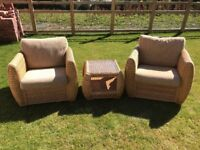 Beautiful wicker chairs and coffee table