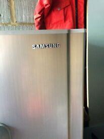 Samsung free standing silver fridge with drinks dispenser