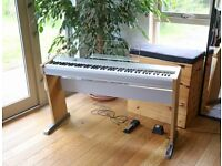 Casio PS 20 digital piano includes integral stand, pedal, manual, plus many learner piano books.