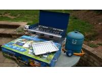 Camping stove with bottle and regulator