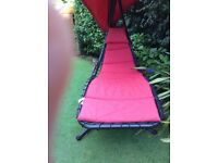 HELICOPTER STYLE SUN LOUNGER/HAMMOCK RED WITH BLACK FRAME. EXCELLENT CONDITION
