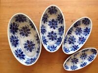 4 oval pottery bowls plus sauce boat and saucer