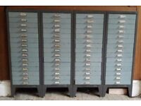 4 x 15-drawer metal filing cabinets. Grey frames, blue drawers. Will sell together or separately