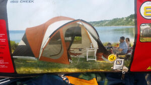 New 8 person tent with screened porch